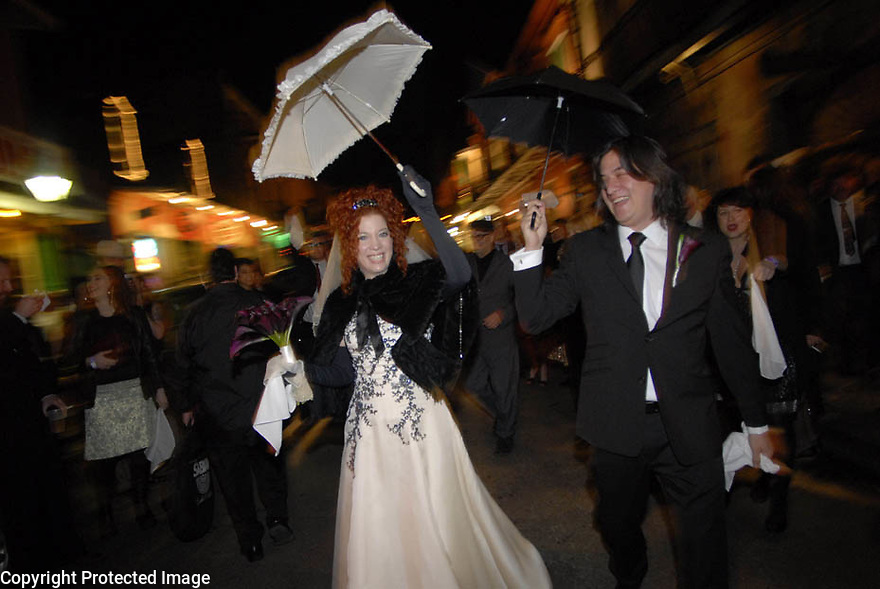 Sean Yseult and Chris Lee secondline through the French Quarter after their wedding in New Orleans, Saturday, Jan. 12, 2008. Weddings, New Orleans Photographer
