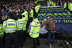 Derby County 1 Nottingham Forest 2, 17/01/2015. iPro Stadium, Championship. An away supporters retrieves a flag a visiting supporters celebrate at the conclusion of Derby Country's Championship match against Nottingham Forest at the iPro Stadium, Derby. The match was won by the visitors by 2 goals to 1, watched by a derby-day crowd of 32,705. The stadium, opened in 1997, was formerly known as Pride Park. Photo by Colin McPherson.