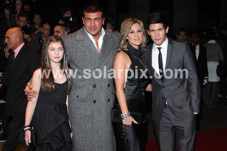 **ALL ROUND PICTURES FROM SOLARPIX.COM**.**WORLDWIDE SYNDICATION RIGHTS**.The UK film premiere of 'Dead Man Running', at the Odeon West End in London...This pic:Tamer Hasan and family..JOB REF:10178       LNJ     DATE:24.10.09.**MUST CREDIT SOLARPIX.COM OR DOUBLE FEE WILL BE CHARGED**.**MUST NOTIFY SOLARPIX OF ONLINE USAGE**.**CALL US ON: +34 952 811 768 or LOW RATE FROM UK 0844 617 7637**