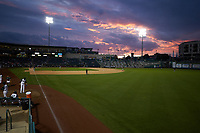 The sun sets behind Parkview Field during the Midwest League game between the Bowling Green Hot Rods and the Fort Wayne TinCaps on August 20, 2019 in Fort Wayne, Indiana. The Hot Rods defeated the TinCaps 6-5. (Brian Westerholt/Four Seam Images)