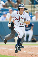 Todd Cunningham #2 of the Rome Braves hustles down the first base line against the Greenville Drive at State Mutual Stadium July 25, 2010, in Rome, Georgia.  Photo by Brian Westerholt / Four Seam Images