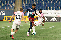 FOXBOROUGH, MA - SEPTEMBER 04: Orlando Sinclair #99 of New England Revolution II controls the ball with Connor Tobin #13 Forward Madison FC and Josiah Trimmingham #44 Forward Madison FC closing in during a game between Forward Madison FC and New England Revolution II at Gillette Stadium on September 04, 2020 in Foxborough, Massachusetts.
