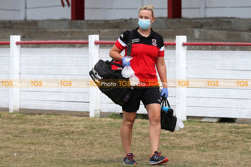 Ramsgate physio, Monique Boorman wears a mask as she walks round the edge of the pitch during Ramsgate vs Folkestone Invicta, Friendly Match Football at Southwood Stadium on 1st August 2020