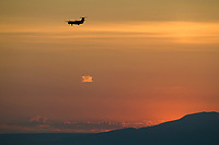 Airplane approaches the Anchorage international airport, Sunset over Sleeping Lady mountain and the cook inlet, Anchorage, Alaska