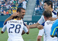 LA Galaxy forward Jovan Kirovski (9) is congratulated by teammate Sean Franklin (28) after scoring a goal. The LA Galaxy defeated the Houston Dynamo 4-1 at Home Depot Center stadium in Carson, California on Saturday evening June 5, 2010..