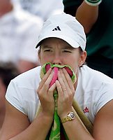 2005 June 21, England , Wimbledon<br /> Justine Henin-Hardenne (BEL) in match play against Eleni Daniilidou (GRE) in the Women's Singles-First round. Daniilidou defeated Henin-Hardenne 7-6, 2-6, 7-5.