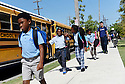 High School students at KIPP Believe Charter School sits on steps during lunch, New Orleans, Aug. 27, 2015.