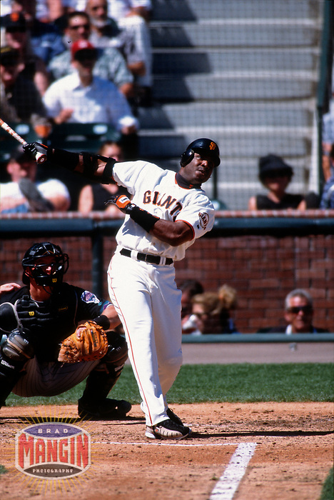 SAN FRANCISCO, CA:  Barry Bonds of the San Francisco Giants hits his 60th home run of the season during a game against the Arizona Diamondbacks at Pacific Bell Park in San Francisco, California on September 6, 2001. (Photo by Brad Mangin)
