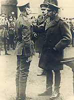 BNPS.co.uk (01202 558833)<br /> Pic:  Spink&Son/BNPS<br /> <br /> Lance Sergeant Arthur Evans receiving the VC from King George V<br /> <br /> A Victoria Cross won by a soldier who swam across a river to single-handedly take out a German machine gun post has sold for £235,000.<br /> <br /> Lance Sergeant Arthur Evans crawled up behind the enemy position and shot the sentry and another soldier before making four more surrender.<br /> <br /> In the same mission he helped cover the withdrawal of a wounded British officer who had been peppered with machine gun fire.