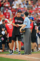 New York Yankees great Paul O'Neill shakes hands with umpire Junior Valentine during the All-Star Legends and Celebrity Softball Game on July 12, 2015 at Great American Ball Park in Cincinnati, Ohio.  (Mike Janes/Four Seam Images)
