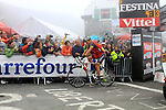 Lance Armstrong (Radioshack) crosses the line at the finish summit of the Col du Tourmalet during a wet foggy Stage 17 of the 2010 Tour de France at Palais Beaumont from Pau to Col du Tourmalet, 22nd July 2010 (Photo by Steven Franzoni/NEWSFILE)