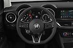 Car pictures of steering wheel view of a 2020 Alfaromeo Stelvio Super 5 Door SUV Steering Wheel