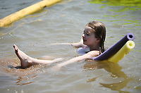 Jordan Collins, 7, of Bella Vista floats on pool noodles, Saturday, July 31, 2021 at the lake at Horseshoe Bend Campground in Rogers. Check out nwaonline.com/210801Daily/ for today's photo gallery. <br /> (NWA Democrat-Gazette/Charlie Kaijo)