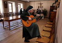 "Nuns practice singing ""Happy Birthday"" to surprise one of their own at Val Mustiar is a world-famous Benedictine Convent of St. John in Switzerland.<br /> <br /> Val Mustiar is a world-famous Benedictine Convent of St. John, which is a UNESCO World Heritage Site.  The alpine monastery was founded by Charlemagne, was built in the 8th centruy, the church houses the world's richest and best preserved series of figuratives Romanesque murals with impressive Carolingian frescos..Since the 12th century the monastery is run by Benedictine nuns.  Eleven make their home behind closed walls, living a life of commitment to poverty and vcelebacy.  The nuns speak a variation of the Romanche language. The dialect changes from valley to valley from Mustair to St. Moritz."