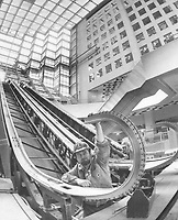 1976 FILE PHOTO - ARCHIVES -<br /> <br /> 1976 FILE PHOTO -<br /> <br /> Royal Bank plaza nears completion; One of 12 escalators being installed in Royal Bank Plaza is checked by workman Tom Hanna in main concourse of complex. It will be opened next year. This newest plaza will consist of twin towers and a two-level concourse of shops and dining facilities. The south tower goes to 41 storeys; the north to 26.
