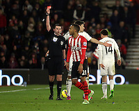 Pictured: Ryan Bertrand of Southampton (C) is shown a red card by match referee Michael Oliver (L) for his foul against Modou Barrow Sunday 01 February 2015<br />