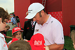 Damien McGrane keeps the fans happy after his round on Day 3 Saturday of the Abu Dhabi HSBC Golf Championship, 22nd January 2011..(Picture Eoin Clarke/www.golffile.ie)