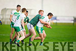 Conor O'Keeffe of Finuge tries his best to stop the advance of Jim Cremin from Ballydonoghue in the Junior Premier Football Championship quarter finals.