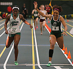 SPEARFISH, S.D. -- FEBRUARY 23, 2013 -- Kaymarie Jones #8 of Adams State edges out teammate Kayon Robinson #17 in the women's 400m event Saturday during the 2013 RMAC Men's and Women's Track and Field Championships at the Donald Young Center on the campus of Black Hills State University.    (Photo by Richard Carlson/dakotapress.org)