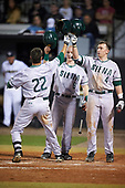 Siena Saints Dan Swain (22) celebrates with teammates Dan Lowndes (8) and Jordan Bishop (4) after hitting a home run during a game against the UCF Knights on February 17, 2017 at UCF Baseball Complex in Orlando, Florida.  UCF defeated Siena 17-6.  (Mike Janes/Four Seam Images)