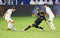 CARSON, CA - SEPTEMBER 06: Danny Musovski #16 of LAFC battles  Emiliano Insua #3  of Los Angeles Galaxy during a game between Los Angeles FC and Los Angeles Galaxy at Dignity Health Sports Park on September 06, 2020 in Carson, California.