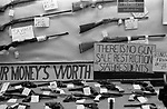 Gun shop guns displayed in the window Gallup New Mexico USA 1972 1970s There is no gun sale restriction to state residents. Your Moneys Worth.