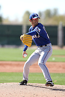 Yoshinori Tateyama #22 of the Texas Rangers participates in spring training workouts at the Rangers complex on February 21, 2011  in Surprise, Arizona. .Photo by:  Bill Mitchell/Four Seam Images.