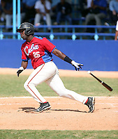 Michael Travieso works out at the Dominican Republic air force base in front of 100+ Major League Baseball scouts prior to being declared eligible to sign since defecting from his native Cuba in Santo Domingo, Dominican Republic on February 11, 2015 (Bill Mitchell)