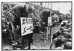 """Top Party officials are denounced during an afternoon-long rally in Red Guard Square: Wang Yilun (left) is accused of being a """"black gang element."""" Harbin, 29 August 1966"""