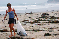 Beach Clean Up Volunteer Melissa Schwartz searches for trash to clean up July 5th, 2008.  Volunteers and organisers of several beach clean-ups in the Pacific and Mission Beach area were stunned by the huge reduction in trash on the beaches compared to what they are used to finding each year on July 5th after beachgoers leave.  The cleanliness of the beaches left many searching the side streets and alleys for trash to collect.