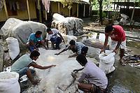 BANGLADESH, District Tangail, Kalihati, village Southpara, tannery, worker salt animal cow skin, after it will processed to leather / BANGLADESCH, Distrikt Tangail, Kalihati, Dorf Southpara, Gerberei, Einsalzen von Tierhaeuten fuer die Lederherstellung