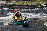 Canoeist on the Hudson River near North Creek on Hudson River in the White Water Derby in the Adirondack Forest Preserve in  New York state