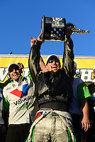 Nov. 11, 2012; Pomona, CA, USA: NHRA funny car driver Jack Beckman celebrates with crew after clinching the 2012 championship during the Auto Club Finals at at Auto Club Raceway at Pomona. Mandatory Credit: Mark J. Rebilas-