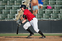 Casey Schroeder (17) of the Kannapolis Intimidators follows through on his swing against the Delmarva Shorebirds at Kannapolis Intimidators Stadium on July 2, 2017 in Kannapolis, North Carolina.  The Shorebirds defeated the Intimidators 5-4.  (Brian Westerholt/Four Seam Images)
