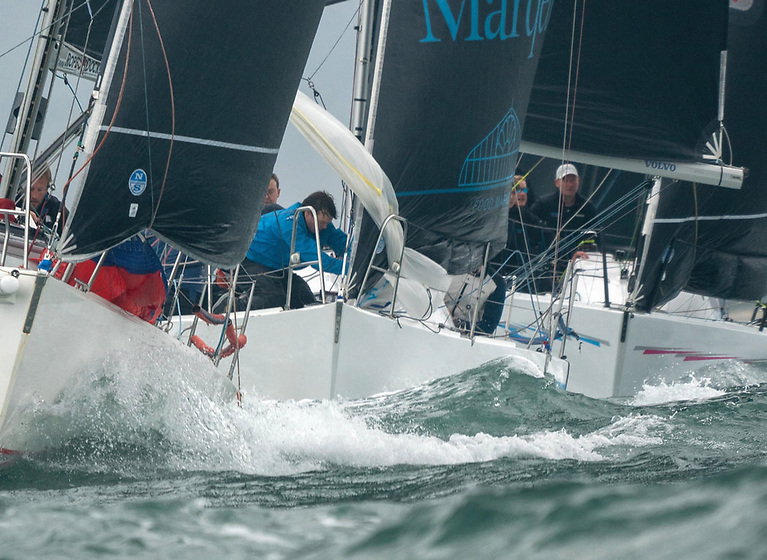 J/109 Storm (Pat Kelly) and the Classic Half Tonners Mata (Wright/DeNeve) and Checkmate XVIII (Nigel Biggs) close in on the mark in the final race of the 20201 Beshoff Motors Autumn League at Howth. Photo: Annraoi Blaney