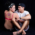 Young danish girl with her boyfriend. She is tattoed with a lotus flower on her upper back, he is tattoed on his foot.<br />