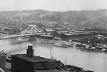Pittsburgh PA:  View looking south towards the South Side and Monongahela River from the bluff at Duquesne University.  The view includes the construction of the 10th Street bridge which opened for traffic in 1933.