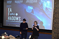 """NEW YORK - OCTOBER 30: Host Glenn Solber and Doborah Shaffer speak at the introduction of the screening of National Geographic Documentary Films """"Sea of Shadows"""" and """"Lost and Found"""" on October 30, 2019 in New York City. (Photo by Anthony Behar/National Geographic/PictureGroup)"""