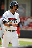Carolina Mudcats infielder Jake Gatewood (7) coming back to the dugout after scoring a run during a game against the Down East Wood Ducks on April 27, 2017 at Five County Stadium in Zebulon, North Carolina. Carolina defeated Down East 9-7. (Robert Gurganus/Four Seam Images)