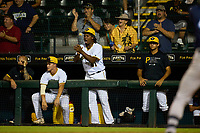 Bradenton Marauders pitcher Luis Ortiz (41) cheers from the dugout during Game Two of the Low-A Southeast Championship Series against the Tampa Tarpons on September 22, 2021 at LECOM Park in Bradenton, Florida.  Jace Bowen (left) and Jared Jones (right) also shown.  (Mike Janes/Four Seam Images)