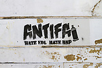 "© Joel Goodman - 07973 332324 - all rights reserved . 30/08/2010 . Brighton , UK . Stencilled graffiti reading "" ANTIFA HATE EDL HATE BNP "" on a Brighton wall . Nationalist group , March for England , hold a march in Brighton , opposed by antifascists . Photo credit : Joel Goodman"