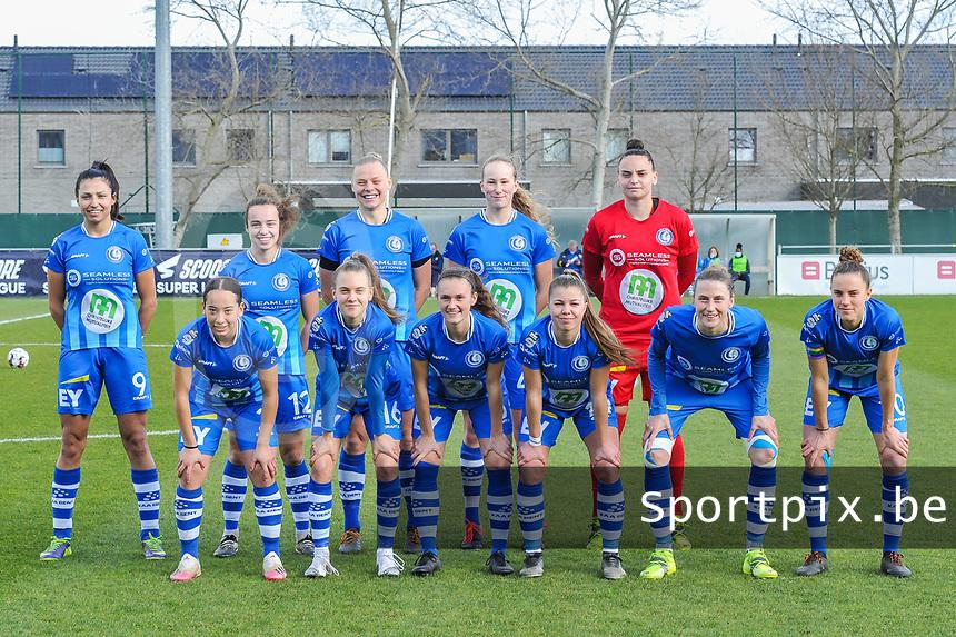 team KAA Gent ( Jolet Lommen (9) , Jasmien Mathys (12) , Ella Van Kerkhoven (3) , Feli Delacauw (44) , goalkeeper Nicky Evrard (1) and Rkia Mazrouai (2) , Alixe Bosteels (16) , Emma Van Britsom (6) , Lyndsey Van Belle (14) , Heleen Jaques (4) , Chloe Vande Velde (10)  ) pictured before a female soccer game between  AA Gent Ladies and Club Brugge YLA on the 16th matchday of the 2020 - 2021 season of Belgian Scooore Womens Super League , saturday 13 th of March 2020  in Oostakker , Belgium . PHOTO SPORTPIX.BE | SPP | STIJN AUDOOREN