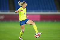 YOKOHAMA, JAPAN - AUGUST 6: Amanda Ilestedt #13 of Sweden conrols the ball during a game between Canada and Sweden at International Stadium Yokohama on August 6, 2021 in Yokohama, Japan.