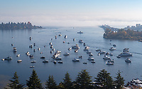 As the fog clears off of Lake Washington, sailgaters are revealed.