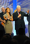 Alicia Keys and Former President Bill Clinton at the Clinton Global Initiative 2009 in New York City.