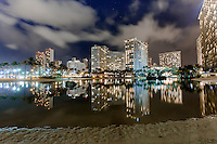 Duke Kahanamoku Lagoon at night, with hotels and their lights reflected in the lagoon's waters, Waikiki, O'ahu.