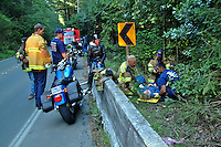 Volunteer firefighters treat the victim of a motorcycle accident in Camp Meeker and Occidental California