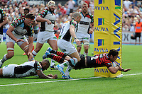 Brad Barritt of Saracens crosses the tryline during the Aviva Premiership semi final match between Saracens and Harlequins at Allianz Park on Saturday 17th May 2014 (Photo by Rob Munro)