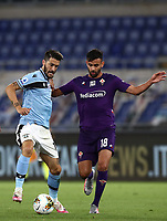 Football, Serie A: S.S. Lazio - Fiorentina, Olympic stadium, Rome, June 27, 2020. <br /> Lazio's Luis Alberto (l) in action with Fiorentina's Rachid Ghezzal (r) during the Italian Serie A football match between S.S. Lazio and Fiorentina at Rome's Olympic stadium, Rome, on June 27, 2020. <br /> UPDATE IMAGES PRESS/Isabella Bonotto