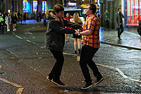 Pictured: Two men jump on the road. Sunday 31 December 2017 and 01 January 2018<br /> Re: New Year revellers in Wind Street, Swansea, Wales, UK